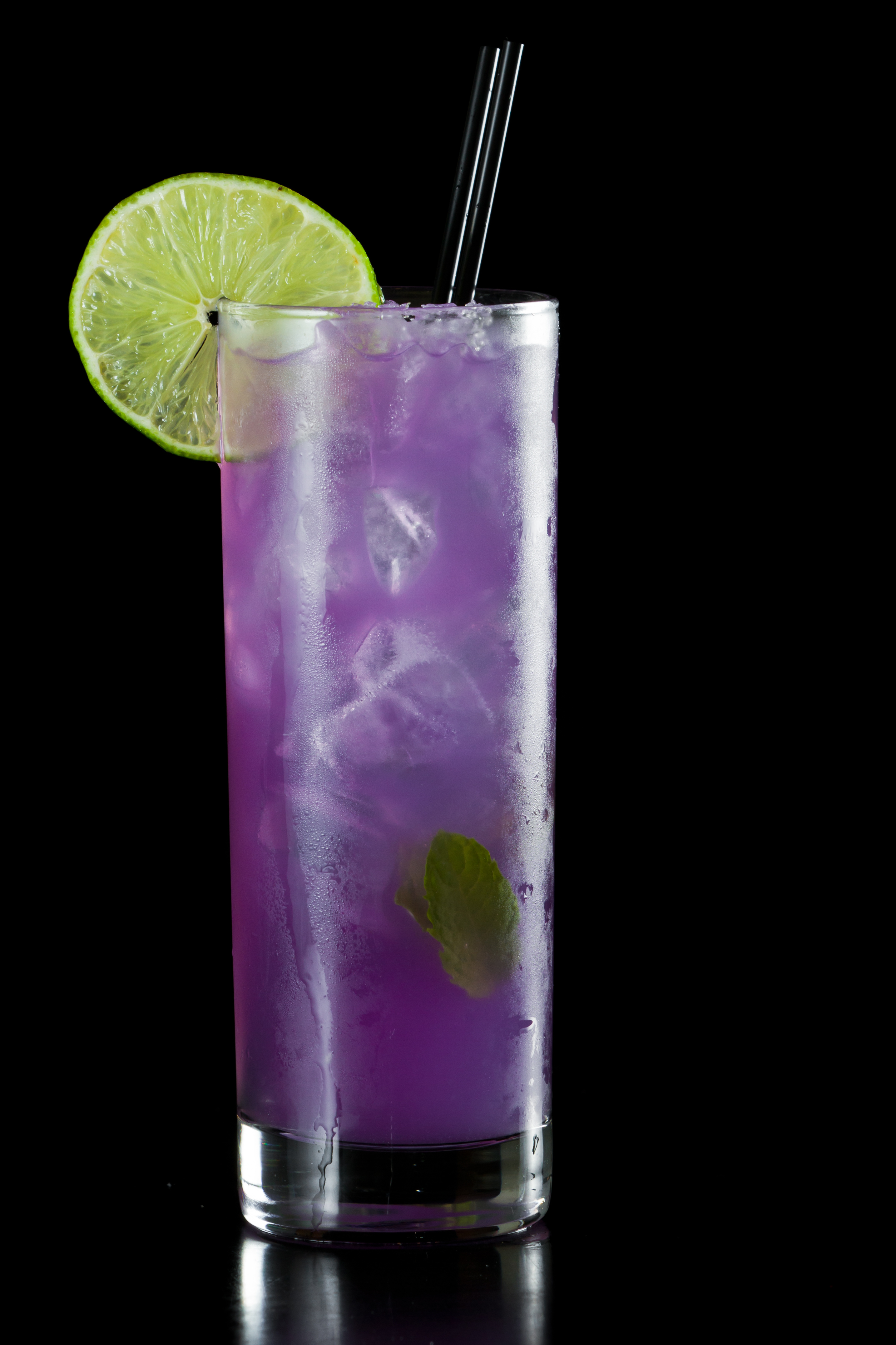A purple rain cocktail has vodka, blue caracao, and a number of nonalcoholic juices in it.